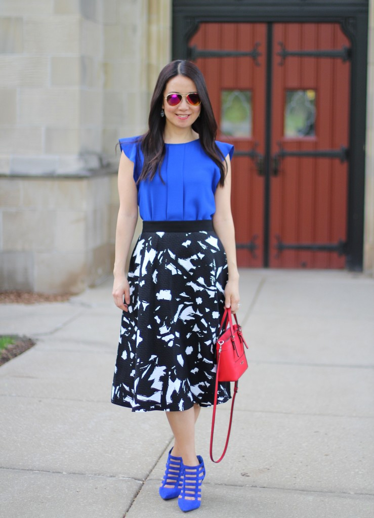 Banana Republic black floral midi skirt, Zara cobalt blue top, Jessica Simpson Carmody caged sandals, GUESS Delaney mini tote, bold colors