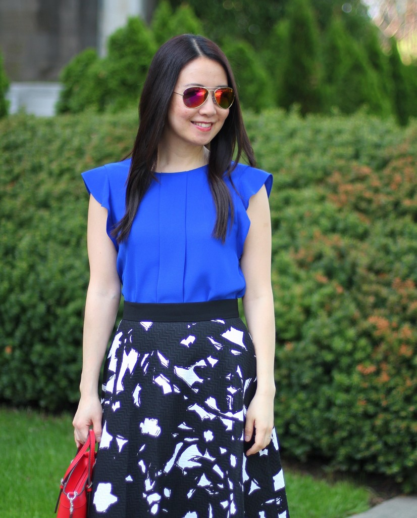 Banana Republic black floral midi skirt, Zara cobalt blue top, GUESS Delaney mini tote, bold colors