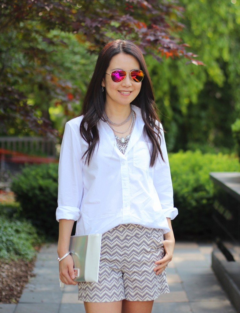 summer fashion, casual glam, classic white shirt, Banana Republic white button down shirt, print shorts, Anthropologie chevron print shorts, Happiness Boutique, layered necklace, Express clutch, date night outfit